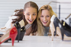 Two excited women looking at heel shoes Royalty Free Stock Photo
