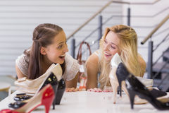 Two excited women looking at heel shoes Stock Photography