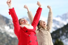 Excited women raising arms in the mountain Royalty Free Stock Photography