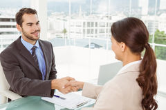 Two executives shaking hands in office Royalty Free Stock Photo