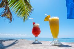 Two exotic cocktails on the table on tropical beach. In Thailand royalty free stock image