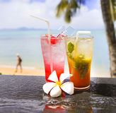 Two exotic cocktails in a tropical setting Stock Photo
