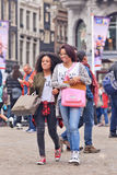 Two exotic girls on Dam Square, Amsterdam, Netherlands Stock Photography