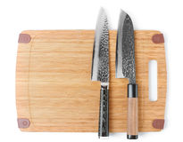 Two expensive japanese knives on cutting board Stock Photo