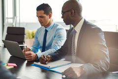Two experienced business executives in a meeting stock image