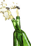 Two exploding beer bottles Stock Photos
