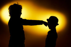 Two  expressive boy's silhouettes showing emotions using gesticu Royalty Free Stock Images