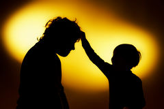 Two  expressive boy's silhouettes showing emotions using gesticu Stock Image