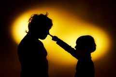 Two  expressive boy's silhouettes showing emotions using gesticu. Lation, isolated on yellow Stock Photos