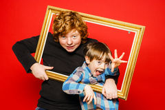 Two expressive brothers studio portrait Stock Images