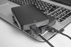 Two external or portable hard drive connected to laptop Stock Photography