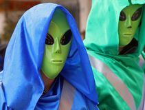 Two extraterrestrial landed on the ground stock photo