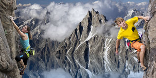 Two extreme climbers hanging on cliff over the Royalty Free Stock Photography