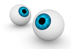 Two eyeballs. Two 3d eyeballs looking into different sides Royalty Free Stock Photos