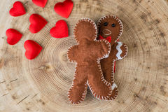 Two fabric gingerbread with hearts on wooden texture, funny love story of valentines day Stock Image