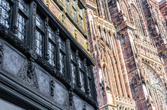 Two facades of Notre Dame Cathedral and Maison Kammerzell Stock Images