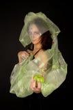 Two-faced Frau mit grünem Apfel Stockbilder