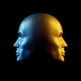 Two-faced head statue, blue and gold Royalty Free Stock Photography