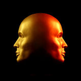 Two-faced head statue, red and gold. Two-faced head statue with one face gold, the other red Royalty Free Stock Images