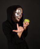 Two-faced sorceress with  apple tempt Royalty Free Stock Photography