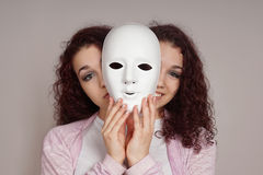 Two-faced woman manic depression concept. Two-faced happy sad woman manic depression or schizophrenia concept Royalty Free Stock Photos