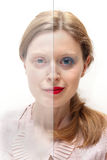 Two faced. Young woman with half of her face covered with makeup and the other half without Royalty Free Stock Photo