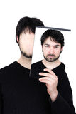 Two faces - focused. Symbolic image of a man holding his face showing changes according to the mood and situation of what seems to be affordable to match the Royalty Free Stock Image
