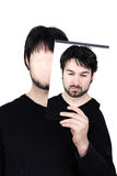 Two faces - think. Symbolic image of a man holding his face showing changes according to the mood and situation of what seems to be affordable to match the Royalty Free Stock Photography
