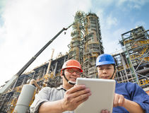 Two Factory workers discussion with tablet pc Stock Image