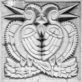 Two fairy birds, bas-relief Stock Photography