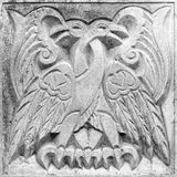 Two fairy fire birds, bas-relief Royalty Free Stock Image