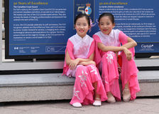 Two Falun Dafa Girls Royalty Free Stock Photos