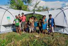 Two familes in front of their disaster relief tents after being made homeless by typhoon Haiyan. Stock Images