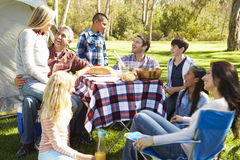 Two Families Enjoying Camping Holiday In Countryside royalty free stock photography