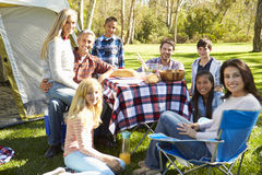 Two Families Enjoying Camping Holiday In Countryside. Smiling At Camera royalty free stock image