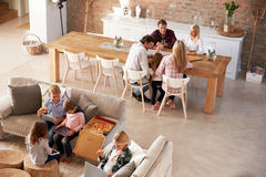 Two families spending time together at home Stock Image