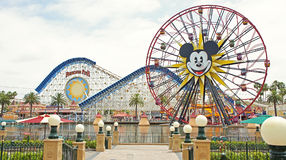 Two famous rides at Disney California Adventure. California Screamin' and Sun Wheel in Paradise Pier are popular rides in Disney California Adventure Royalty Free Stock Photo