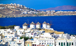 Two of the famous windmills in Mykonos, Greece during a clear and bright summer sunny day stock photos