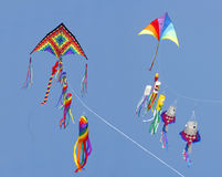 Two Fancy Kites Flying in a Bright Blue Sky Royalty Free Stock Photos