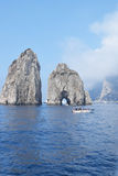 Two of the Faraglioni rocks with boat near by, Capri, Italy. Two of the Faraglioni rocks with boat close by, Capri, Italy Royalty Free Stock Photo