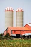 Two farm silos. And an orange barn Royalty Free Stock Image