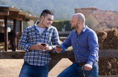 Two farmers with phones Stock Images