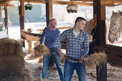 Two farmers with pitchforks Stock Photos