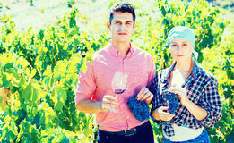Two farmers posing with wine and grape Royalty Free Stock Photos