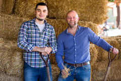 Two farmers in a shed Royalty Free Stock Photo