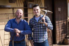 Two farmers standing with spades Stock Photography