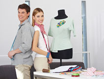 Two fashion designer with dress form Royalty Free Stock Photography