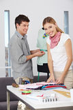 Two fashion designer at work Stock Photography