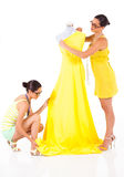 Two fashion designers. Working on a dress royalty free stock image