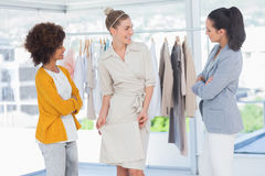 Two fashion designers looking at model Royalty Free Stock Images